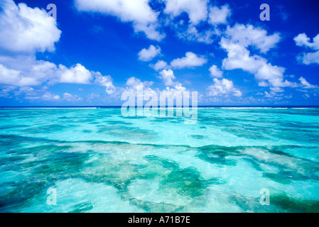 View over shallow water flat on La Digue Island in Seychelles Indian Ocean - Stock Photo