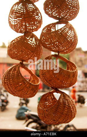 Baskets are hanging outside the dry fruit shop in the state of Jammu and Kashmir, India - Stock Photo