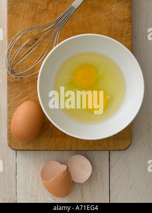 Eggs in bowl with whisk and broken shells - high end Hasselblad 61mb digital image - Stock Photo