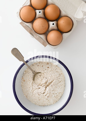 Flour and eggs on white background - high end Hasselblad 61mb digital image - Stock Photo