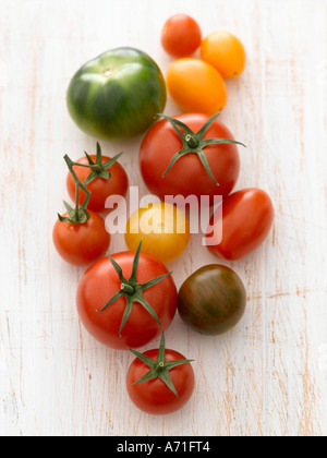 Assorted tomatoes on white washed wood - high end Hasselblad 61mb digital inage - Stock Photo