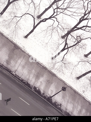 Man running across street (Michigan Avenue) on a wintry day in Chicago USA - Stock Photo
