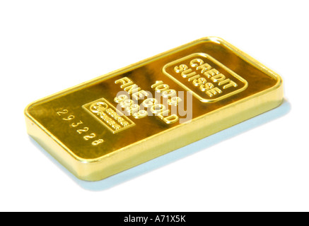 Close up of a 100 grams heavy solid gold bar from Swiss company Credit Suisse - Stock Photo