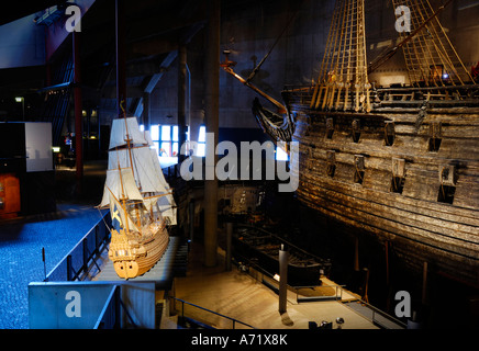 A 3-4 meters long model of the 17th century battleship Vasa (real ship in the background) at the Vasa museum in Stockholm Sweden