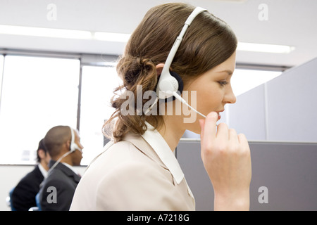Young woman working in call center - Stock Photo