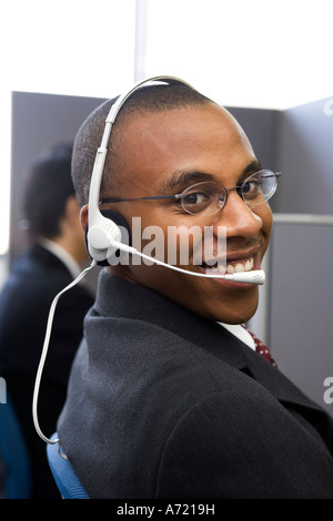 Young man working in call center - Stock Photo