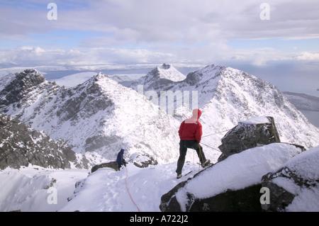 a climber belays his partner on Sgurr Alasdair, Cuillin Ridge, Isle of Skye, Scotland, UK - Stock Photo