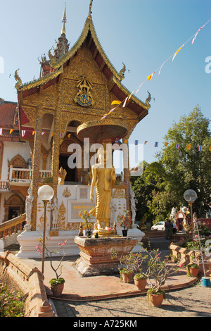 Buddha image in front of Wat Bupparam building. Chiang Mai, Thailand. - Stock Photo