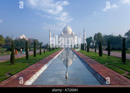 Taj Mahal mausoleum in early morning light with reflection in water pool Agra Uttar Pradesh India Asia - Stock Photo