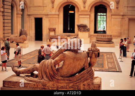 Interior of The Louvre Museum Paris France - Stock Photo