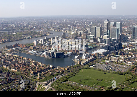 Aerial high level oblique view north west of Canary Wharf Millwall Inner and Outer Dock Docklands Isle of Dogs London - Stock Photo