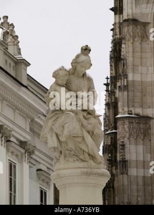 Passau, city view statue of Virgin Mary and Jesus - Stock Photo