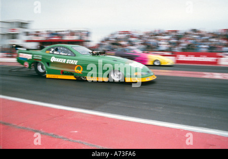 Funny car race Quaker state oil Adrenaline rush extreme risk danger methanol alcohol - Stock Photo