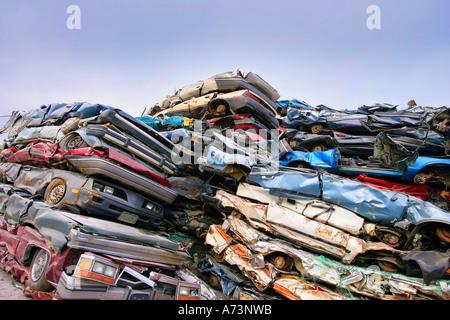 Cars in a scrap metal lot - Stock Photo