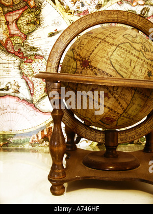 Antique globe and world map. - Stock Photo