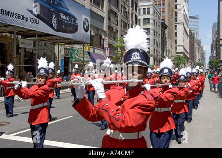 Member of a high school band plays the flute as he marches down Madison Avenue in New York City during the Filipino - Stock Photo