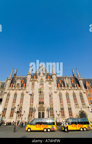 Vertical wide angle view of the Provincial Court in the Markt [Market Place] against a bright blue sky. - Stock Photo