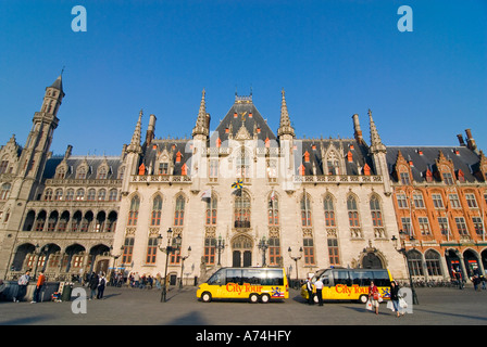 Horizontal wide angle view of the Provincial Court in the Markt [Market Place] against a bright blue sky. - Stock Photo