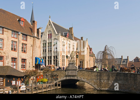 Horizontal view of the canal at Sint-Jan Nepomucenusbrug bridge in central Bruges on a beautiful sunny day. - Stock Photo
