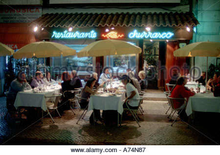 EU, Portugal, Lisbon. Restaurant row where tourists and locals enjoy typical Portuguese dishes. - Stock Photo