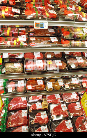 Packaged meats in a display case in Large US Supermarket - Stock Photo