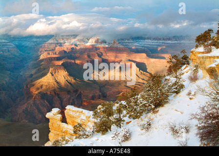 View of the Grand Canyon and a clearing winter storm from near Mather Point Arizona - Stock Photo