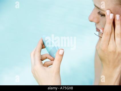 Woman tweezing brows - Stock Photo