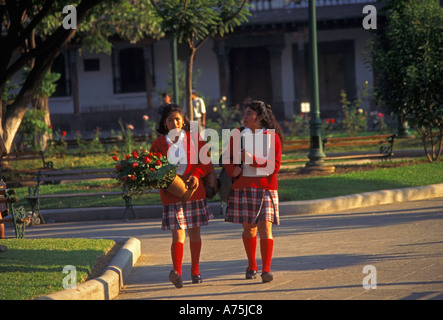 2 two Guatemalans teenage girls Guatemalan students schoolgirls friends getting together in Plaza Mayor in Antigua - Stock Photo