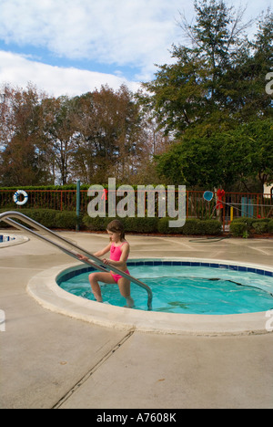 A Young Girl Swimmer Climbing Out Of A Swimming Pool Picture Scott Stock Photo 82332155 Alamy
