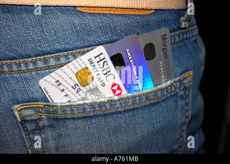 Credit cards sticking out of a rear pocket. - Stock Photo