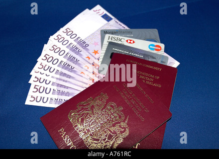 Money credit cards and passport - Stock Photo