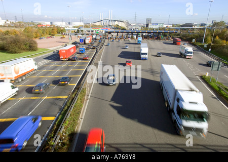 A wide view of traffic at the tolls of the QE2 bridge on the M25 motorway with slow shutter speed for motion blur. - Stock Photo