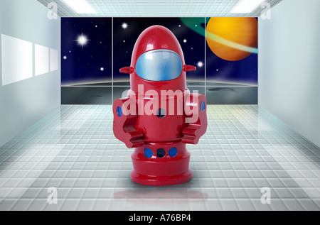 Bright red plastic seventies spaceman robotic toy on a computer generated background. - Stock Photo
