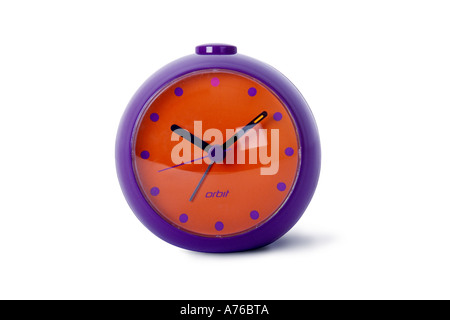 Colourful purple and red orange alarm clock on a pure white background. - Stock Photo