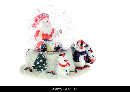 Kitsch Christmas scene snow dome or globe on a pure white background. - Stock Photo