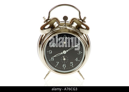 Traditional chrome alarm clock on a pure white background. - Stock Photo