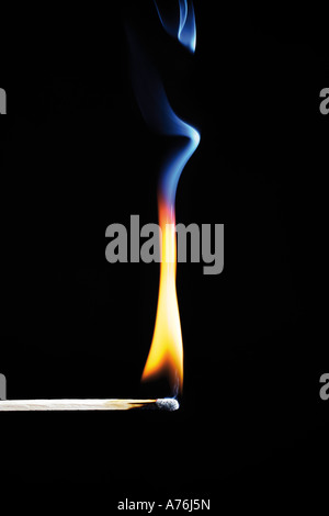 Burning match on black background, close-up - Stock Photo