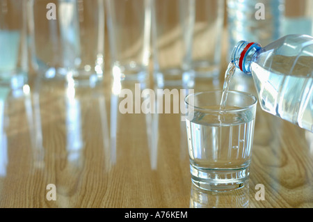 Water being poured into glass, close-up - Stock Photo