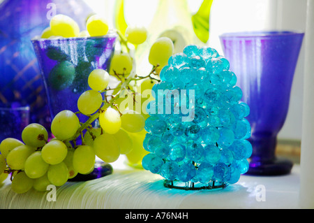 Glasses and storm light on table - Stock Photo