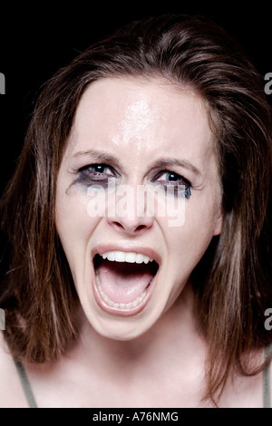 Young woman crying, portrait - Stock Photo