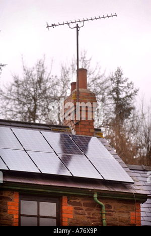 SOLAR PANELS ON A COTTAGE ROOF HEREFORDSHIRE UK - Stock Photo
