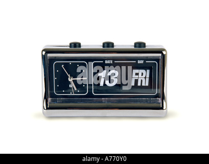 1970's style retro bedside alarm clock and calendar displaying Friday 13th on a pure white background. - Stock Photo
