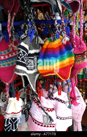 Colourful woollen hats on sale on a market stall in central Prague March 2006 - Stock Photo