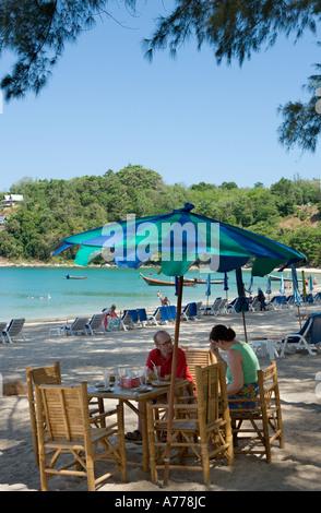 Couple sitting at a beach bar, Kamala Beach, Phuket, Thailand - Stock Photo