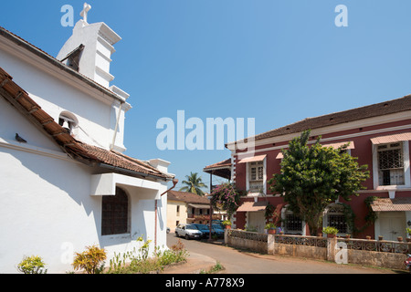 Church  and houses in the old historic quarter of Fontainhas, Panaji or Panjim (the Goan capital city), Goa, India - Stock Photo