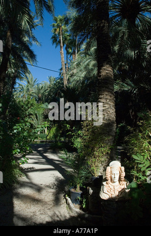 Replica of the Lady of Elx Priest Orchard in The Elx Palm Grove / ELCHE / Spain - Stock Photo