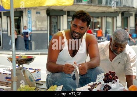 Mauritius island,Port Louis, Mauritian Men at Food Market - Stock Photo