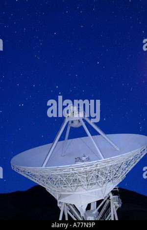 Owens Valley Radio antenna Array looking at blue dusk sky - Stock Photo