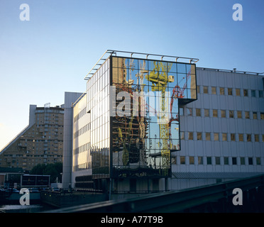 Reflection of building works at Docklands London shown in office building - Stock Photo