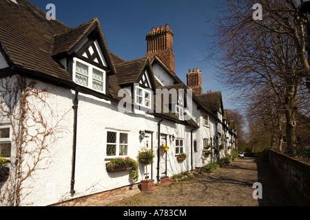 UK Cheshire Vale Royal School Lane Great Budworth cottages beside St Marys Parish church - Stock Photo